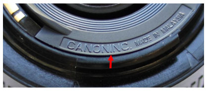"Fake lenses have no space between the ""Canon"" and the ""Inc."""